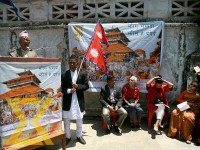 A man speaks during a programme organised to mark the second anniversary of the 2015 earthquake at Basantapur Durbar Square in Kathmandu on Tuesday.