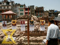 A man looks at the pictures of the people who lost their life during the devastating earthquake of 2015 at Basantapur in Kathmandu on Tuesday.