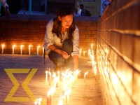 A girl lights a candle in memory of the people who lost their life in the April 25, 2015 devastating earthquake, at Maitighar Mandala in Kathmandu on Tuesday.