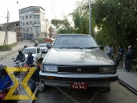 A car parked at a main road being towed on a truck for breaching the traffic rule at Anamnagar in Kathmandu on Tuesday.