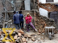 Workers clear the rubble from a dismantled house at Maru in the Capital on Tuesday.