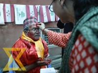 Nepali Congress candidate Chiri Babu Maharjan receives Tika from his relatives and supporters after winning the mayoral race from Lalitpur Metropolitan City, at Pulchok, Lalitpur on Wednesday.