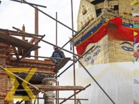 A worker reconstructs the Anantapur Temple in front of Swayambhunath Stupa in the Capital on Thursday.