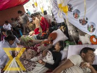 Nurses check health of teachers, who have been staging hunger strike for the past three days demanding to scrap the discriminatory vacancy announcements, at Bhadralaki in Kathmandu on Friday.