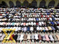 People from Muslim Community attend the last prayers during the holy month of Ramadan at Kashmiri Mosque in the Capital on Friday.