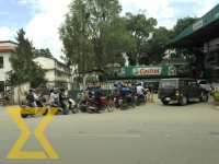 Motorcyclists queue up to refill petrol at a fuel station in the Capital on Friday.
