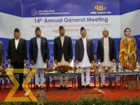 Prime Minister Sher Bahadur Deuba (4th, L) attends the 14th Annual General Meeting of the Confederation of Nepalese Industries at Soaltee Crowne Plaza in the Capital on Friday.