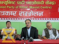CPN (Maoist Centre) Chairman Puspa Kamal Dahal (center) addresses a press conference organised after the conclusion of party secretariat meet at Paris Danda in Kathmandu on Sunday.