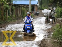 A scooter wades through a waterlogged road at Thapathali in Kathmandu on Wednesday.