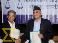 Shajha Party coordinator Rabindra Mistra and Bibeksil Dal chairman Ujjal Thapa shake hands after the merger of two parties at Baneshwor in Kathmandu on Wednesday.