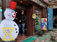 A snowman made of plastic cups is put outside a cafe in Patan Durbar Square, Lalitpur on Tuesday.