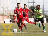 Players from Tribhuvan Army Club (red jersey) and Manang Marshyangdi Club (lemon green jersey) vie for the ball during the Martyrs Memorial 'A' Division League at the ANFA Complex in Satdobato, Lalitipur on Friday.