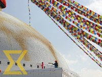 A woman cleans the dome of Boudhanath Stupa in Kathmandu on Sunday.