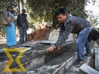 Conservation activists bring down the concrete structure at Shlesmantak forest area on Sunday. They claim the structure was built against the directions from the Archeological Department.