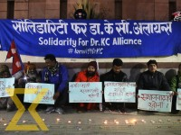 Members of Solidarity for Dr KC Alliance stage a sit-in demanding government to address the demands of Dr Govinda KC at New Baneshwor, Kathmandu on Monday.