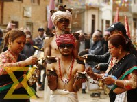 Devotees offer oil to youths impersonating as Hindu God Madhav Narayan during the Madhav Narayan Festival celebrated in Thecho, Lalitpur, on Saturday.