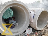 A homeless man sleeps in a drain pipe on the banks of Bishnumati River.