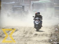 A motorcyclist heads towards his destination through a cloud of dust along the Kalanki-Nagdhunga road section on Saturday.