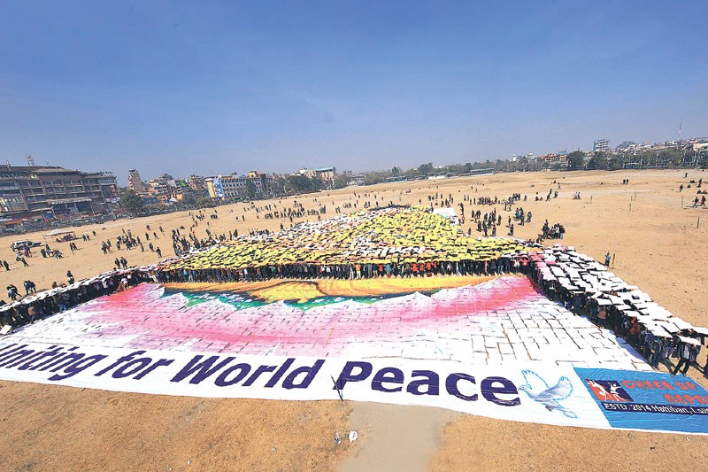 Thousands gather to create the 'Largest Human Buddha'