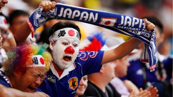 Japan fans clean up stadium after win