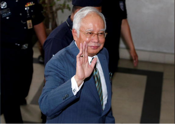 Malaysia's Najib pleads not guilty to money laundering as charges pile up