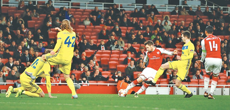 Arsenalu0027s Mathieu Debuchy (second Right) Shoots To Score A Goal Against Bate  Borisov During Their Uefa Europa League Match At The Emirates Stadium In  London ...