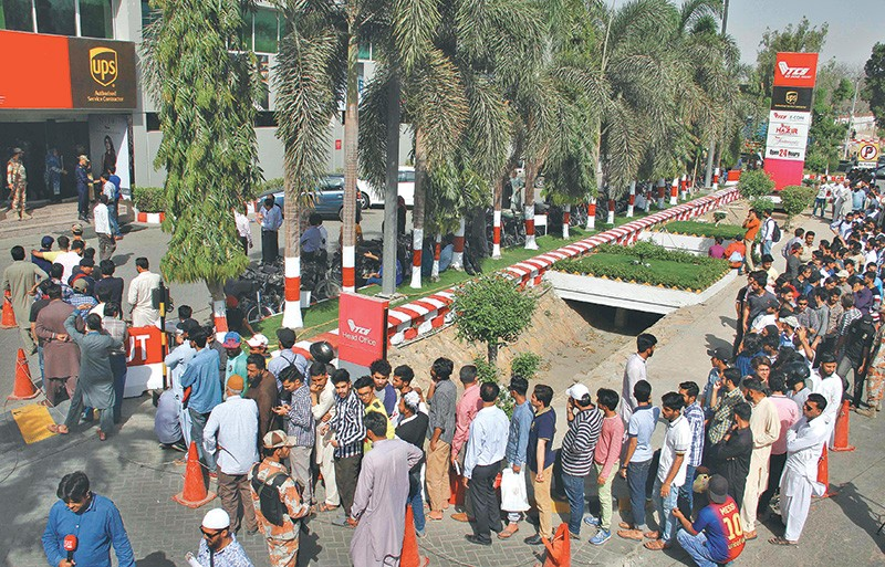 A File Photo Of Pakistani Cricket Fans Queuing Up To Buy Tickets For Pakistan Super League Final Match In Karachi Afp Rss
