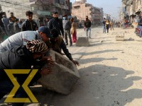Locals in Kalanki obstruct the road on Wednesday demanding blacktopping of dusty road from Soalteemode to Nagdhunga.