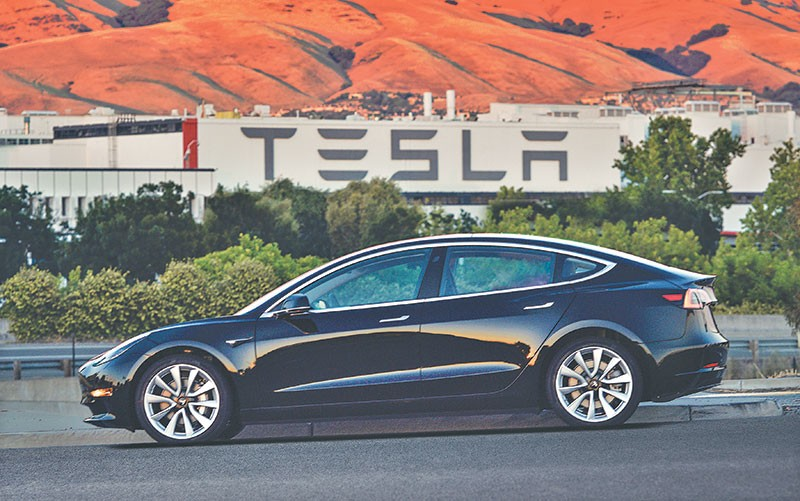 Tesla Delivers Its First Lower Cost Model 3 Cars